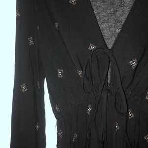Deep V Neck Black Romper With Pattern on it